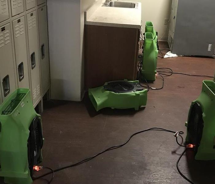 locker room with green air movers.